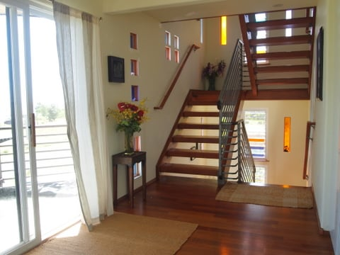 sunlight streaming and reflected on teak floors, Magic, one floor leads to  the next