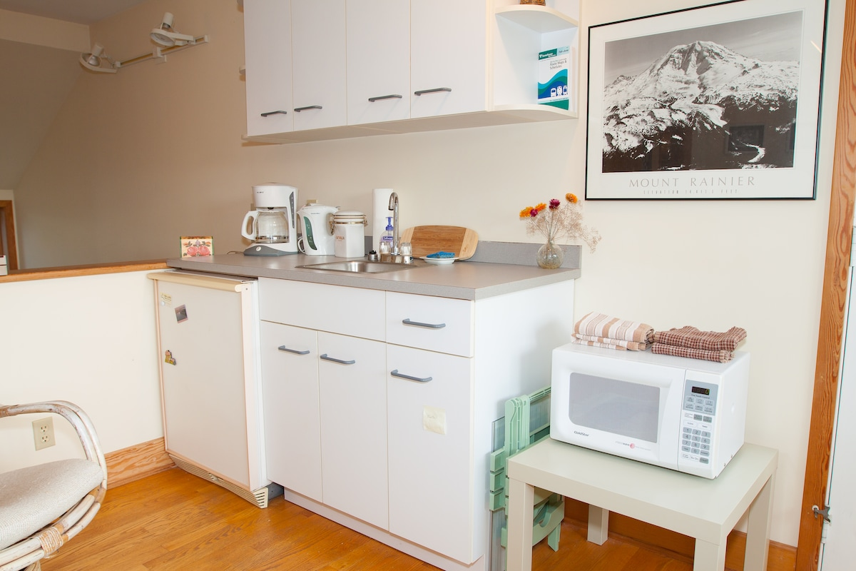 Kitchenette in sitting room - sink, micro and frig.