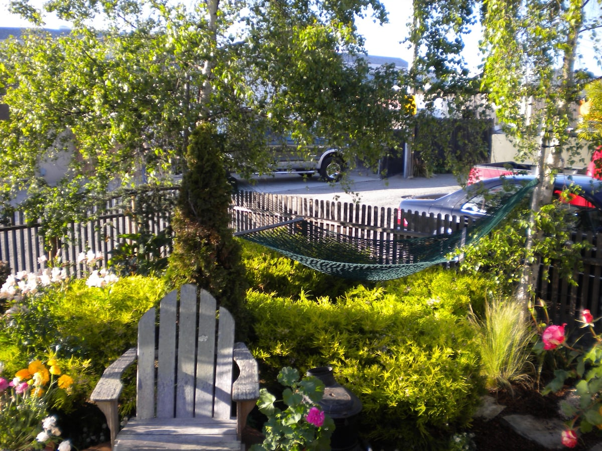 In spring, summer and fall the garden is beautiful.  Hammock is being restrung now, so it's not setup yet.  Notice- we are in a mixed use area- mixture of homes and businesses.