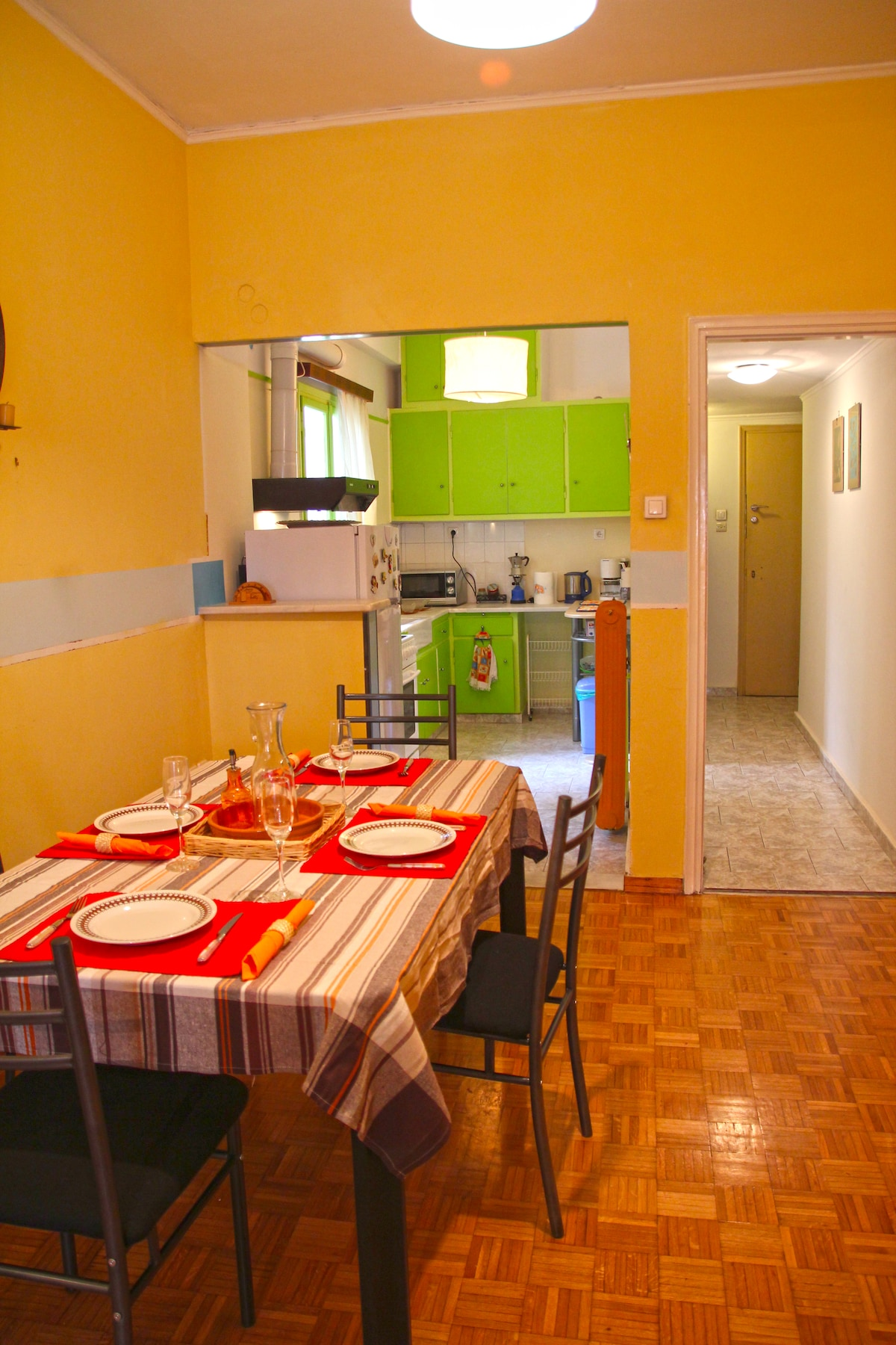 This is the dining room and view to the colorful kitchen.