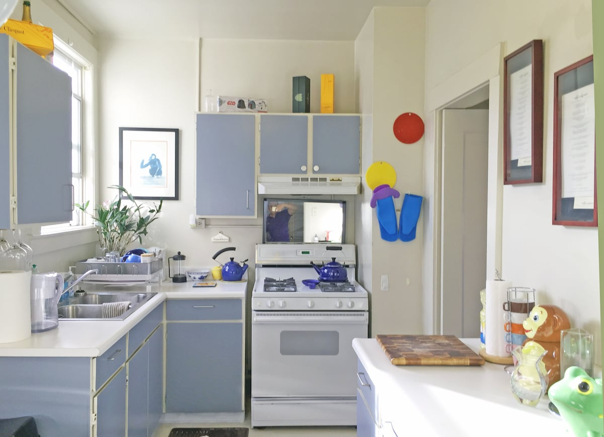 Here's the kitchen. It's bright and sunny during the day. There's a gas stove and oven with freezer and refrigerator. Pots and pans and silverware too will allow you to cook a nice meal or two.