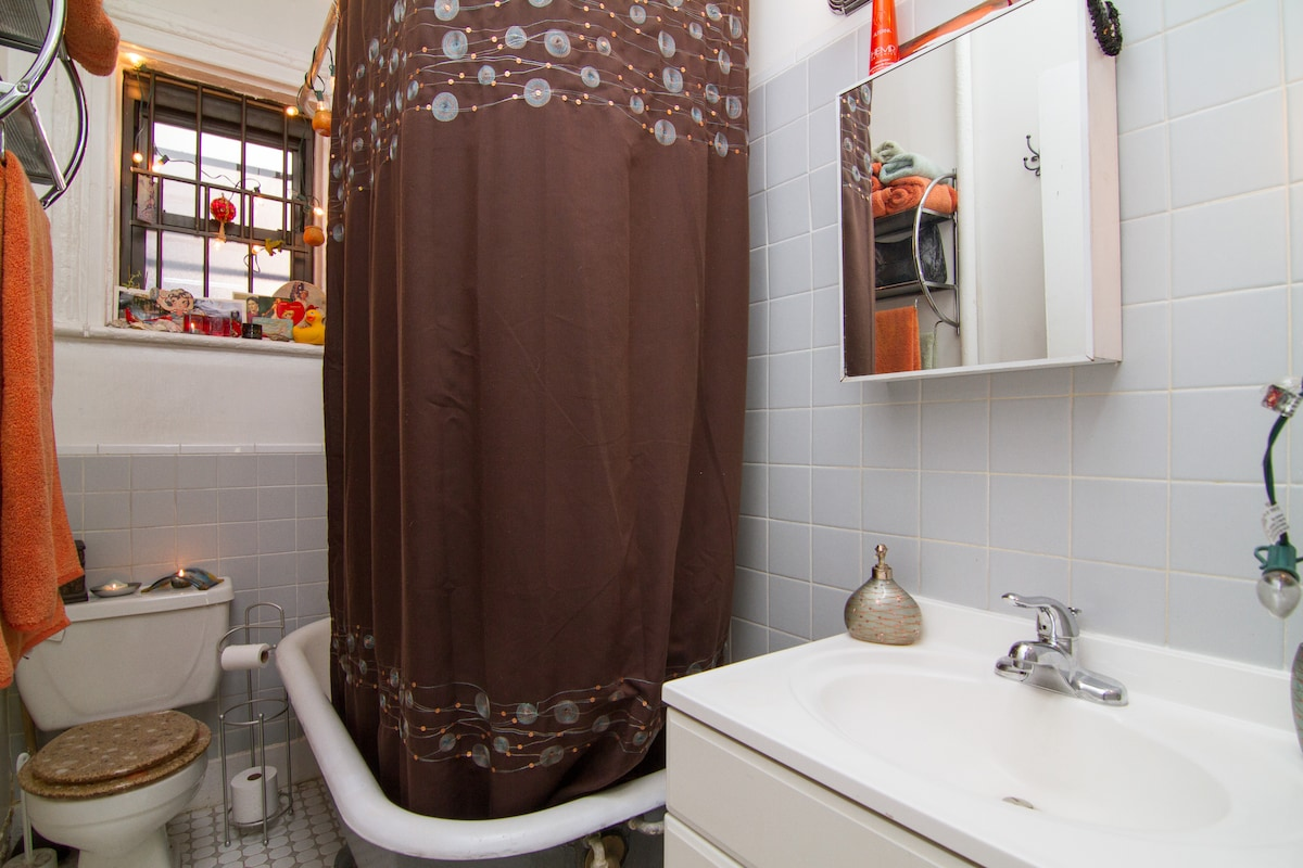 Bathroom with antique, clawfoot tub, much larger than it appears in photo :)