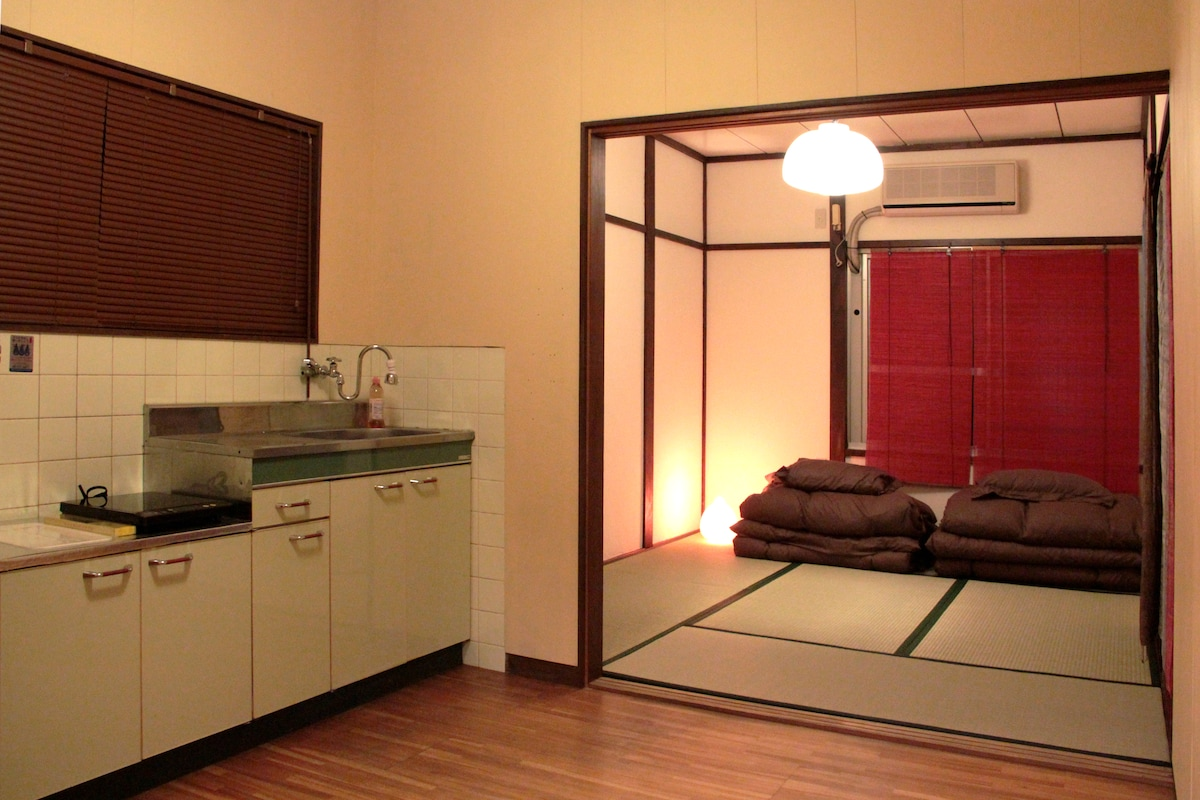 It is a lovely old house, with traditional Japanese style private rooms.Our rooms have futons (Japanese mattress) and tatami mats.