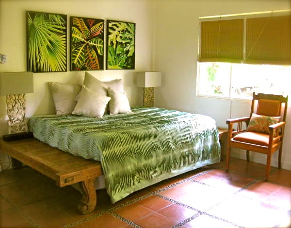 Downstairs Bedroom queen size bed antique platform bed with view to north and family temple.