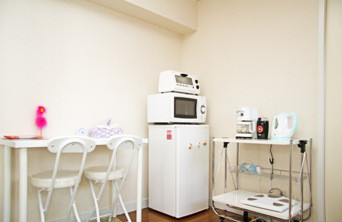 Dining area, fridge, microwave, toaster, coffee maker, coffee beans grinder, hair dryer, etc