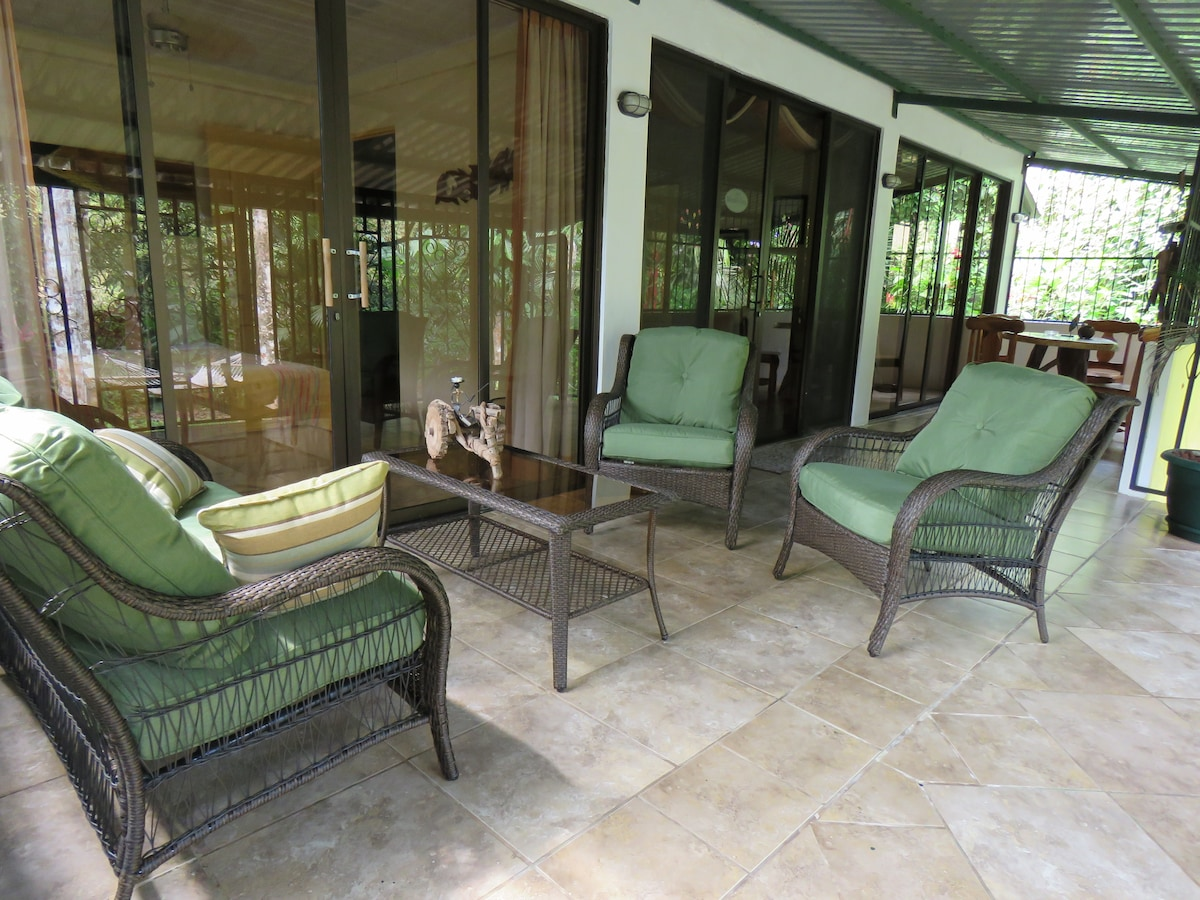 Both bedrooms and living area open to large covered, gated deck overlooking garden and creek