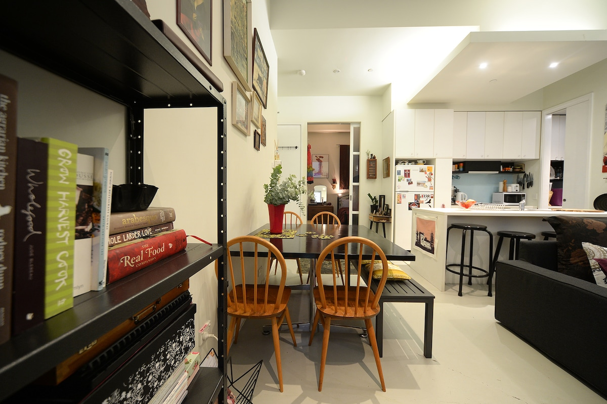 Large dining table, plenty of seats, bookcases with an eclectic mix of fiction, travel, cooking & art books