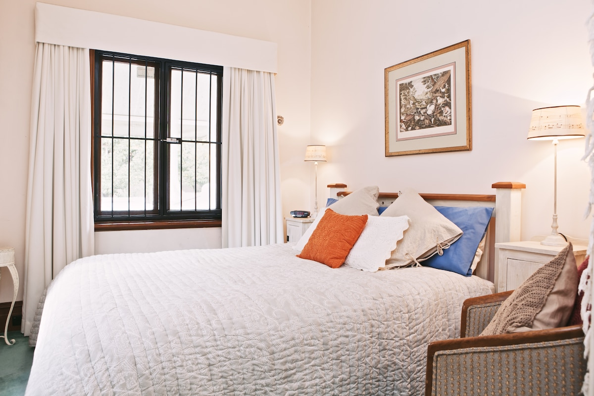 The room is cozy and quiet away from the street and backing onto a park.