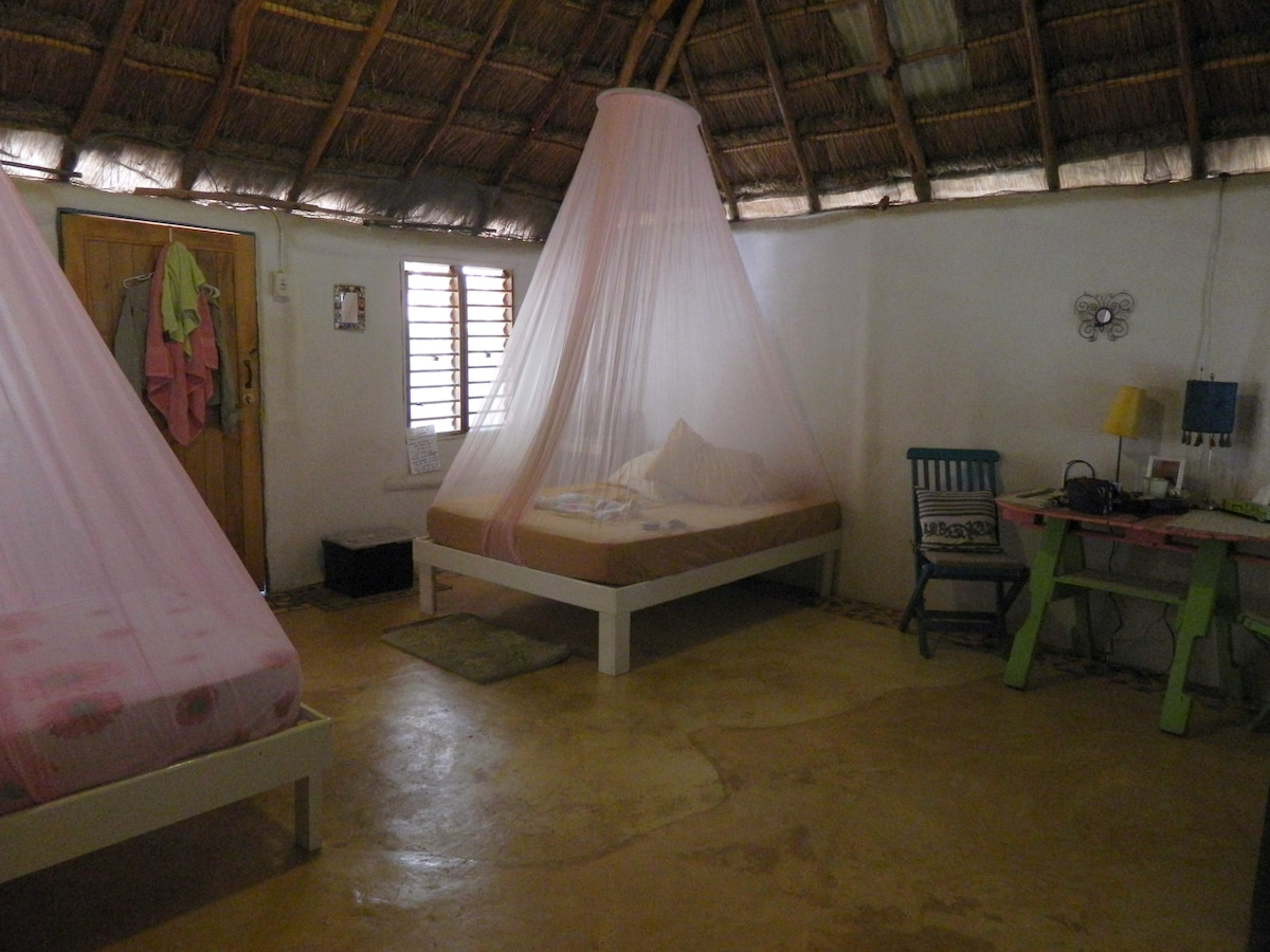 Inside the cabin - one double and one single bed with mosquito nets for your comfort and safety.
