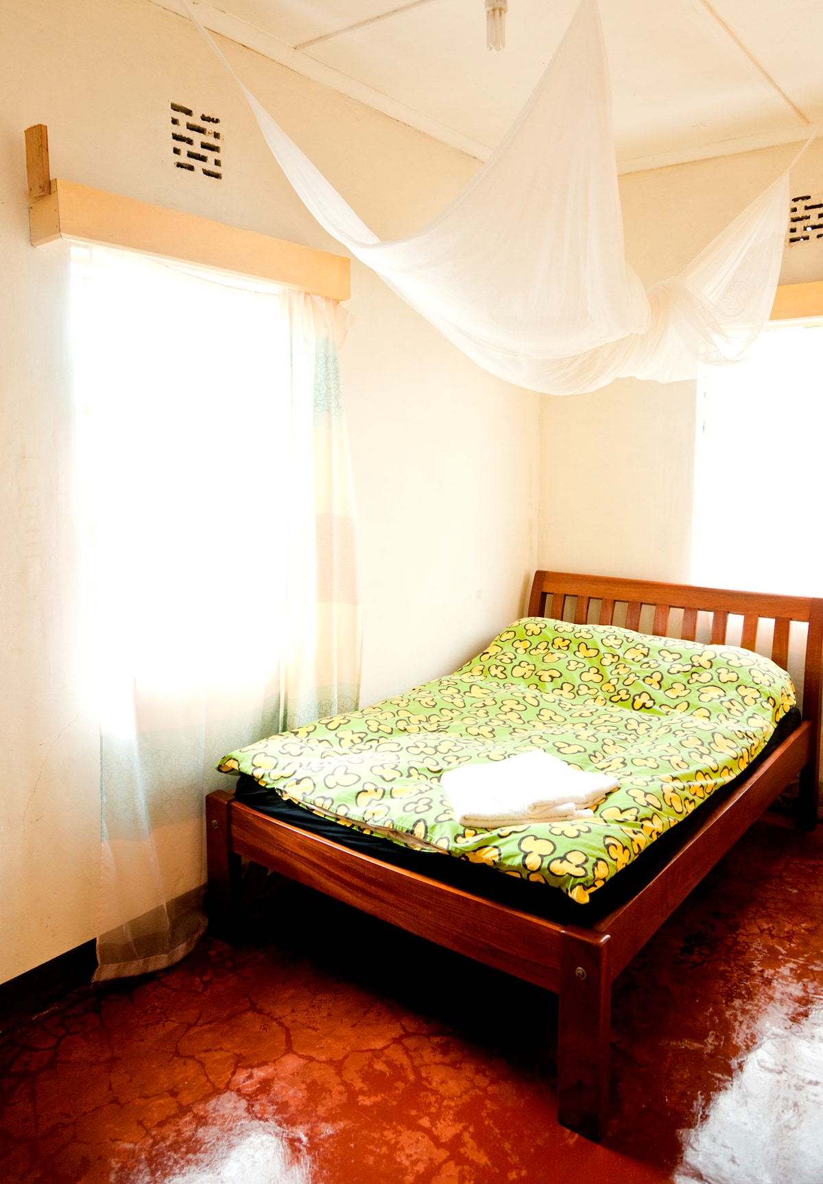 Room 1, two windows with view onto the garden and the Ngong Hills