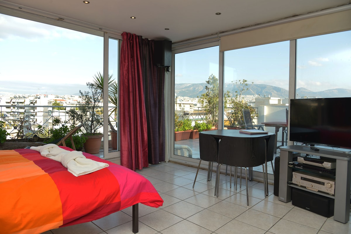 Enjoy the beautiful Panoramic view from your bed.Our area is one of the safest in Athens, with no parking problem (public parking, toll free)