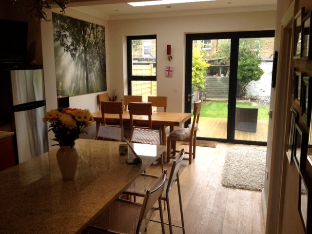 Our lovely kitchen, dining and chill out space - with a fantastic deck with rattan loungers..
