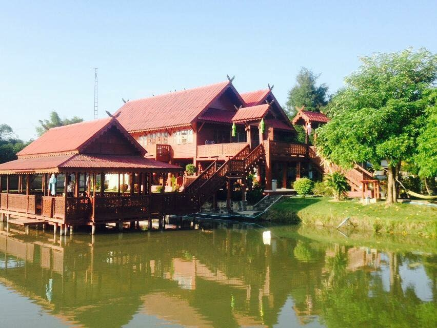 Solid teak wood house for that warm, country feel that all city dwellers crave.