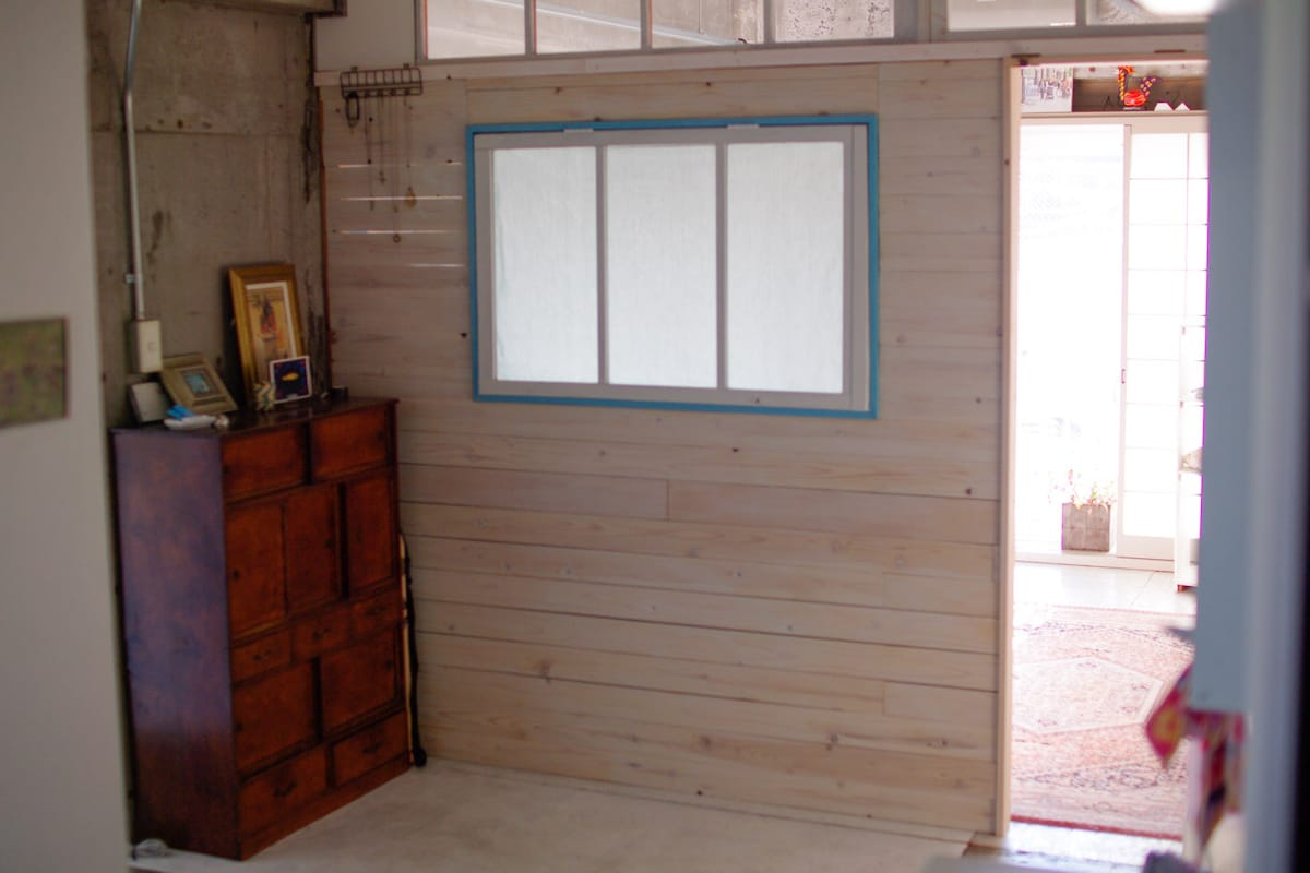 The wall and entrance of the bed room. the bed room is 3.5x3.5meters square size. wood floor, with large window. you can walk out to balcony. As you can see it is not completely private room.