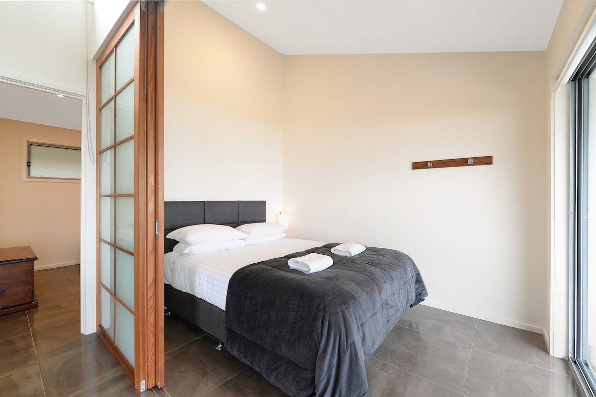 Main bedroom, with beach view. Lie in bed and watch for dolphins and whales