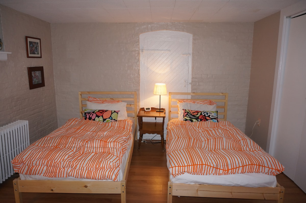 Two twin beds in the bedroom can be combined to make a king sized bed.