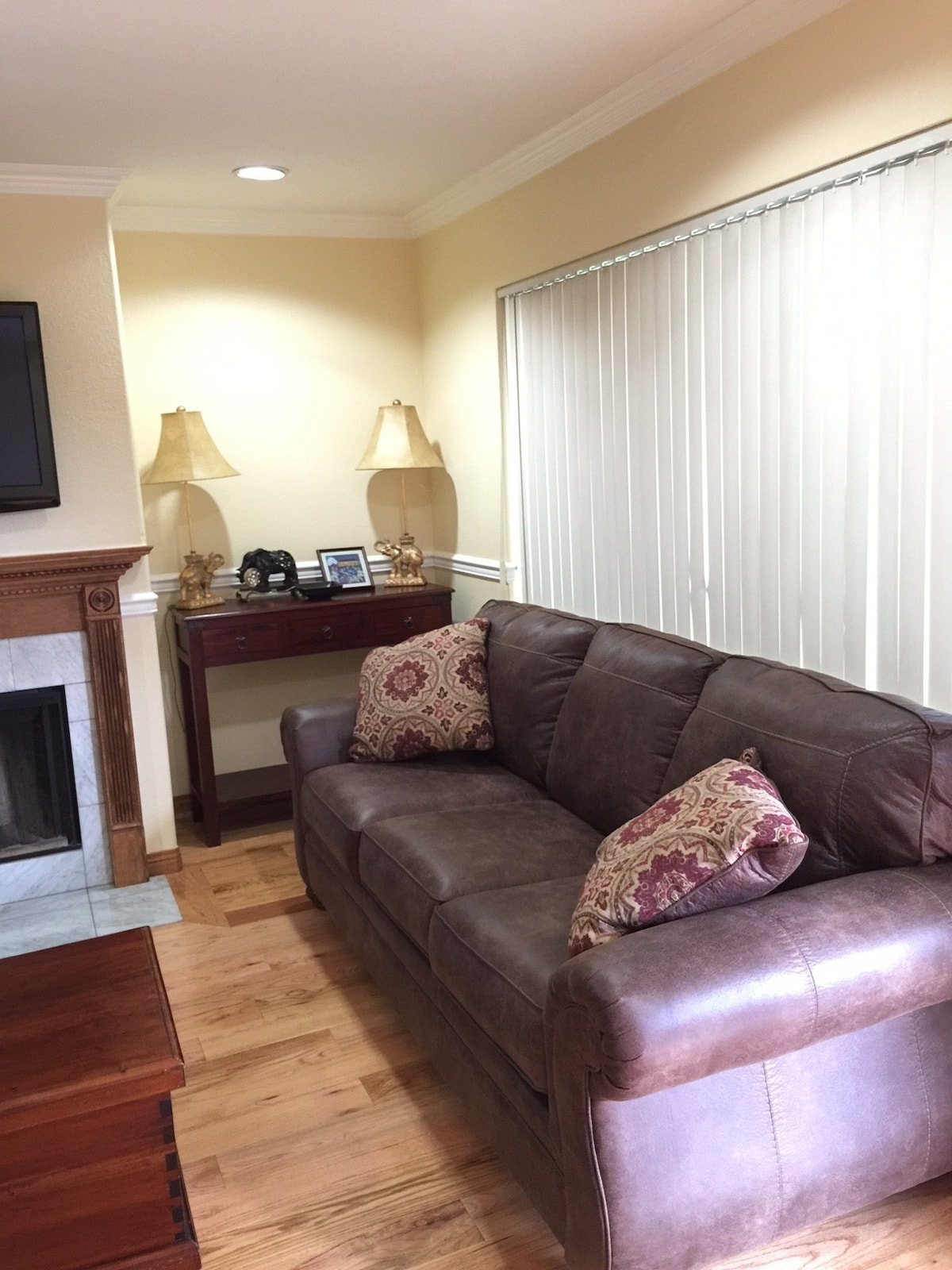 Comfortable sofa with fireplace