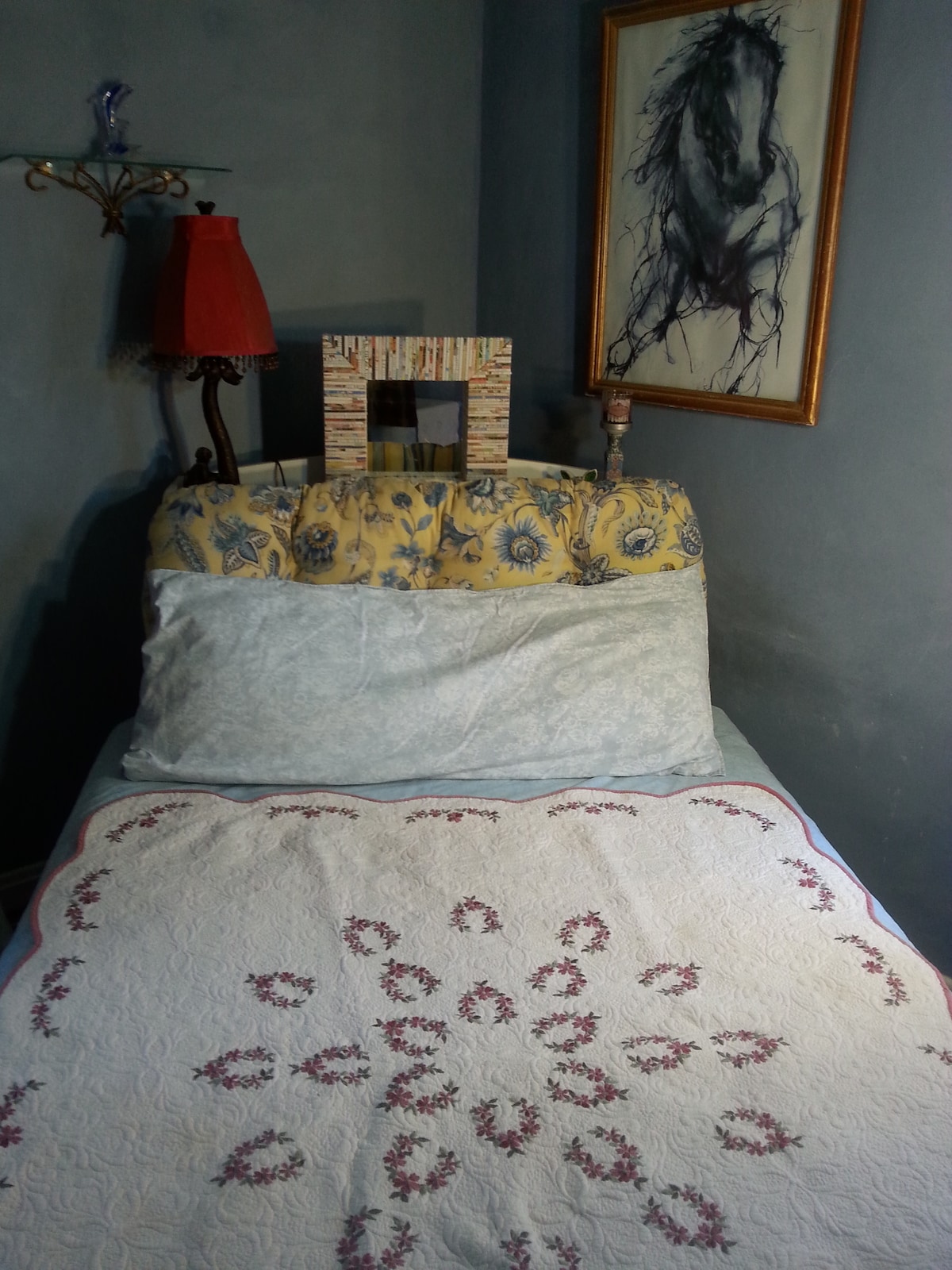 Full sized bed angled for easy in/out on both sides