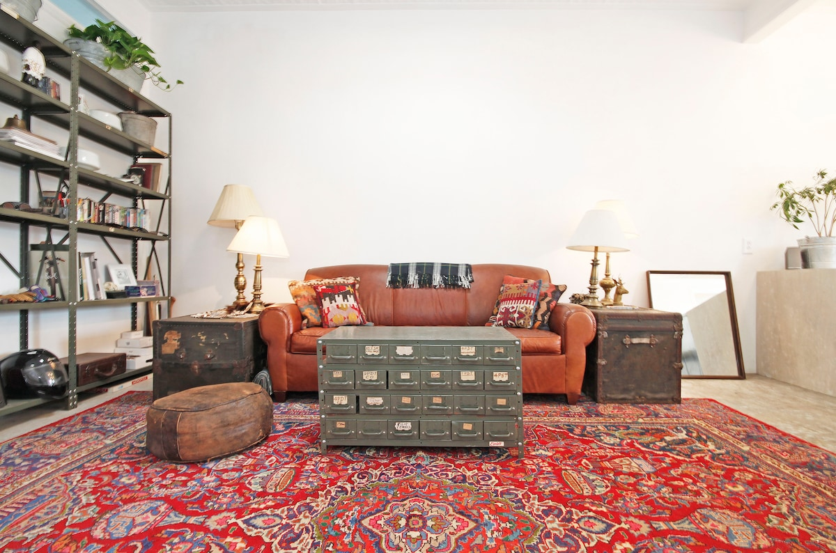 I like vintage things with a great patina and hidden stories. That couch has a hidden bed.