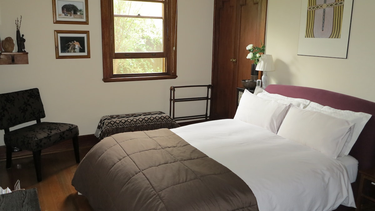 Jarrah timber and lovely heritage feel to this comfortable bedroom