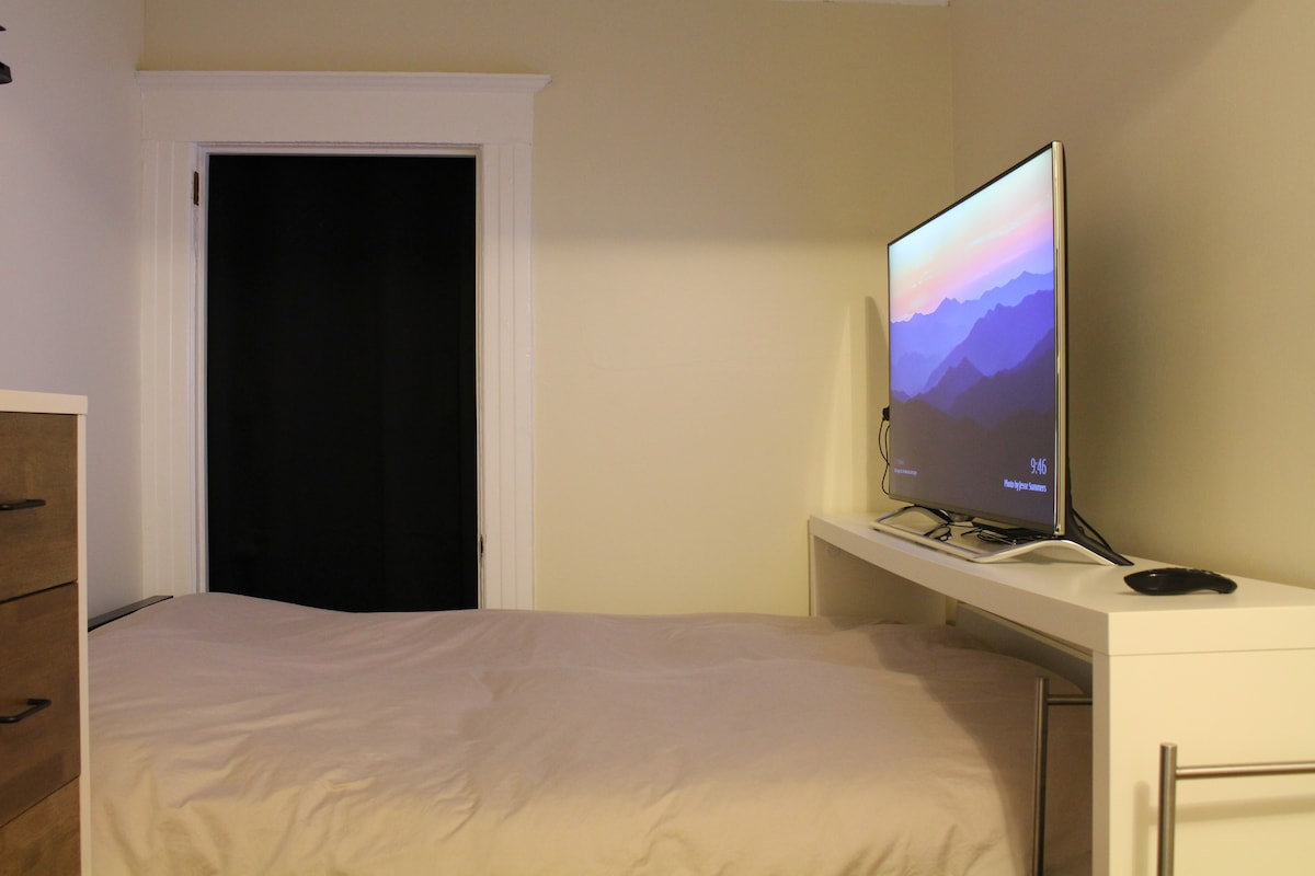 There is a closet, full size bed with a comfortable memory foam mattress, and a 49-inch 4K 3D TV that you can watch. It has Netflix, Amazon Prime, Chromecast, and local channels.