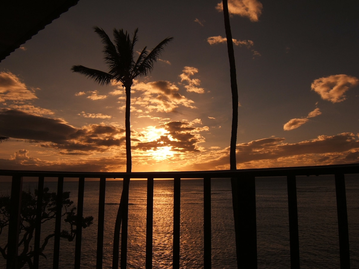 Sunset view from the lanai (deck). This truly is an oceanfront condo ... 30 feet to the Pacific!!
