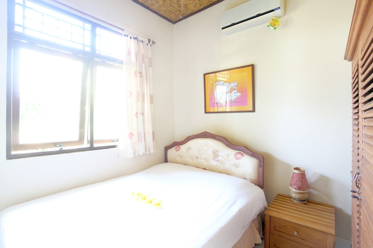 Two bedrooms, this is the one with double boxspring bed, European size.