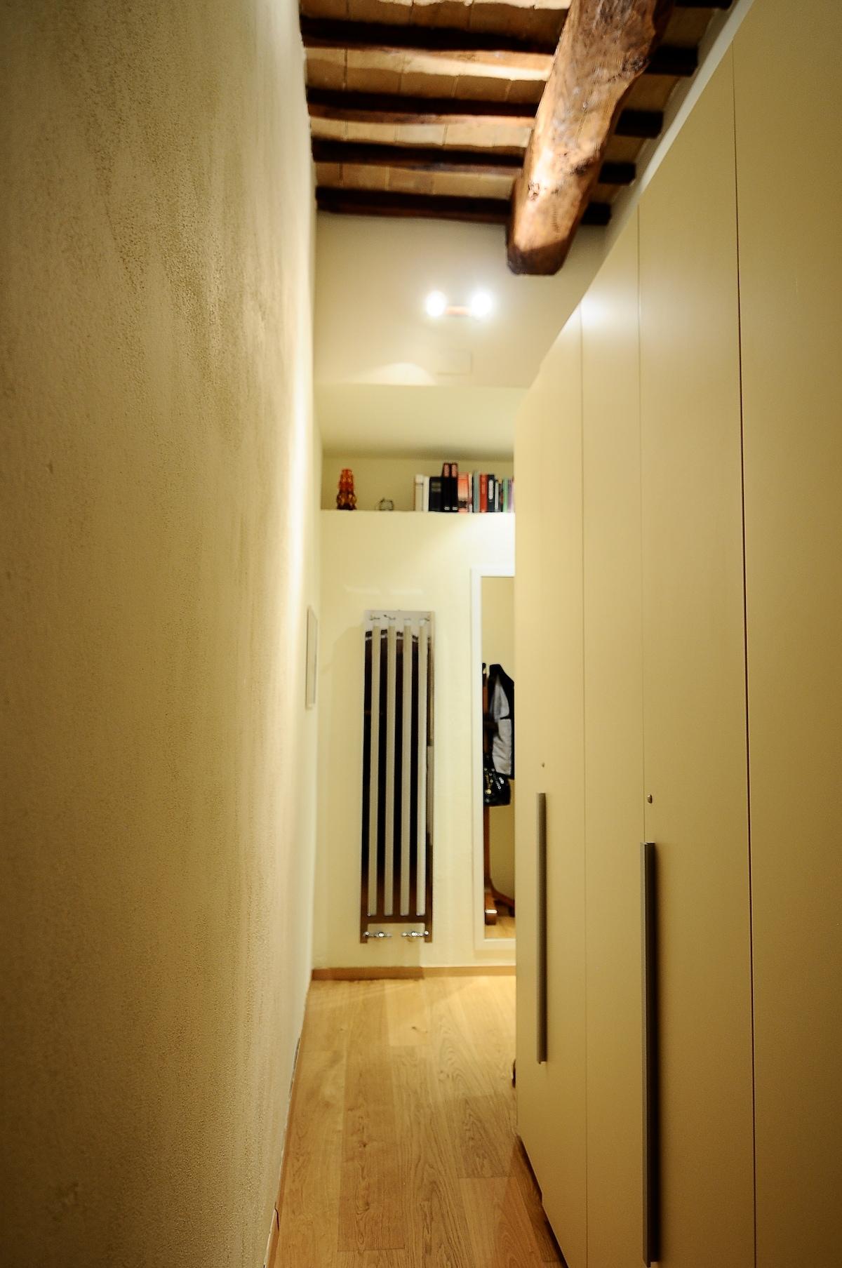 long hallway with wardrobe