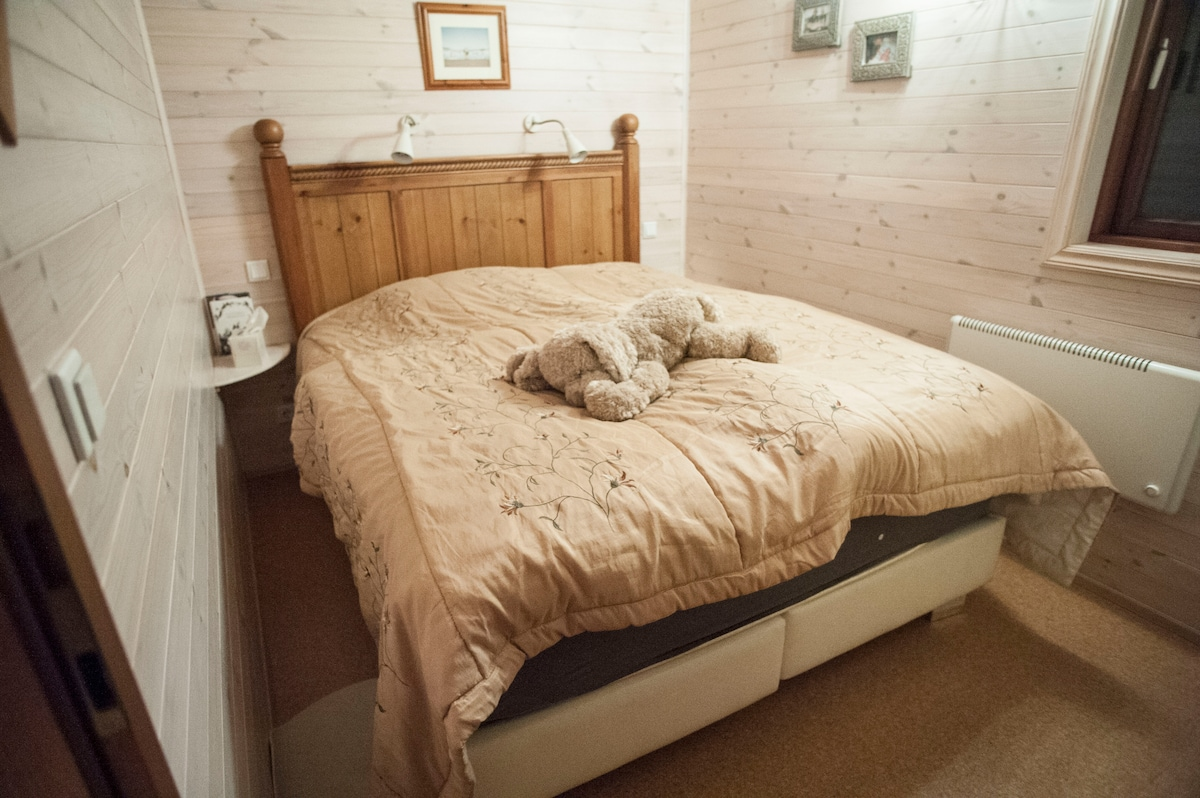 A comfy double bed with super warm bedding and a window into the quiet country side.