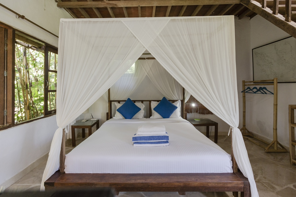 Comfortable double bed with mosquito net