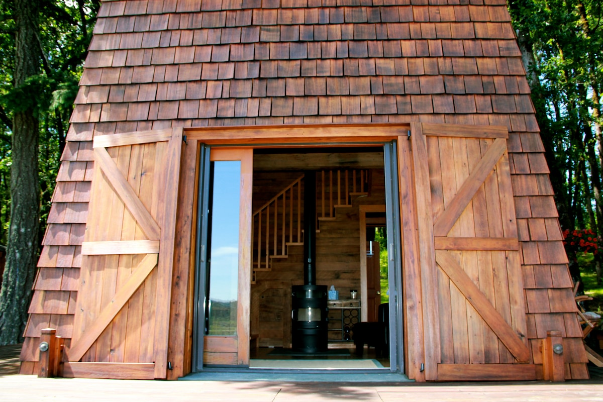 View into the living room - cabin is made of 100% recycled cedar wood.
