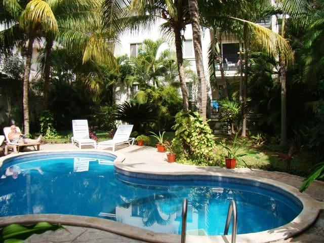 Relax by the pool surrounded by lush tropical gardens.