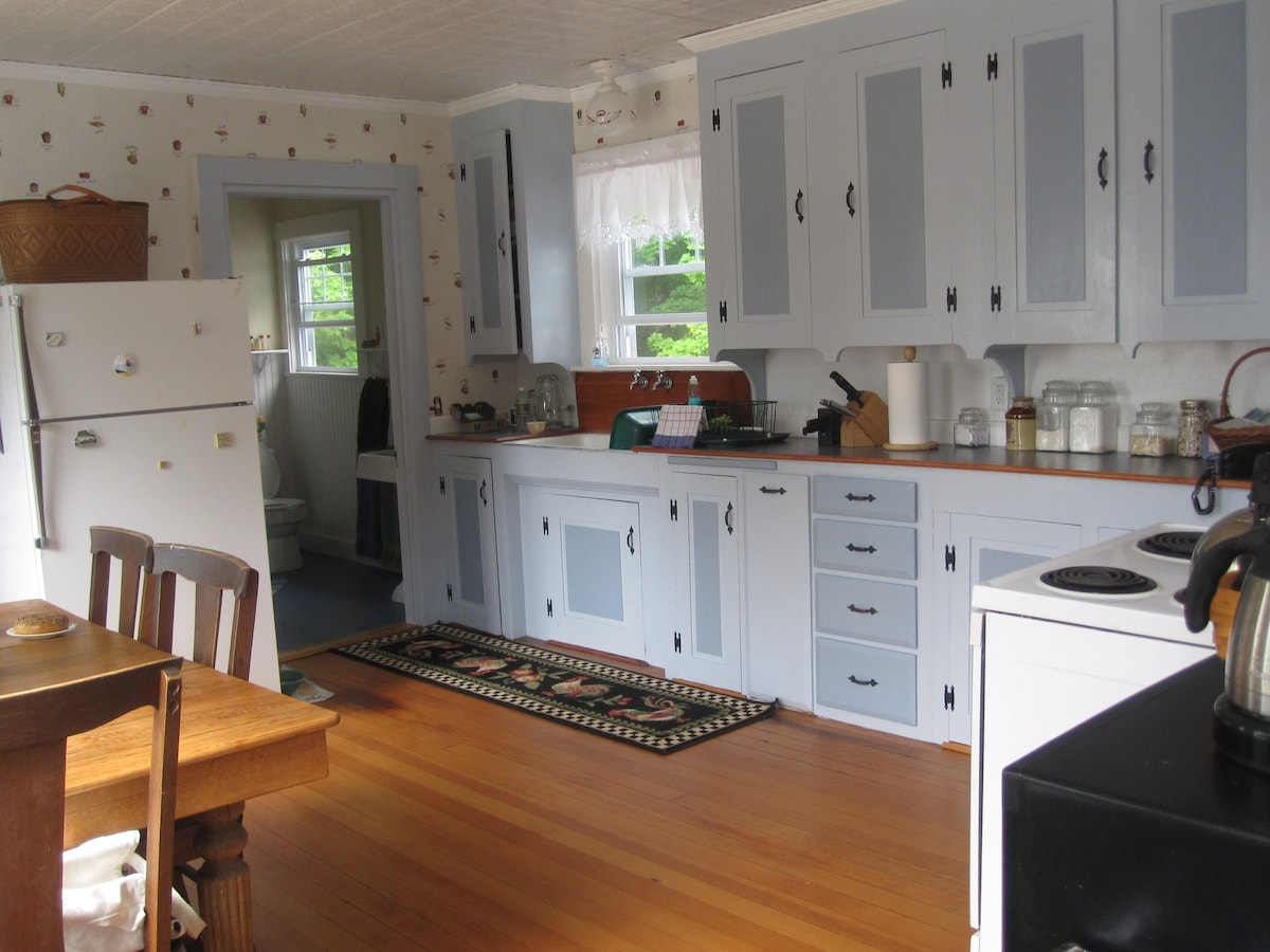 our large, country kitchen.  my grandfather built the cabinets here, and in the bathroom.