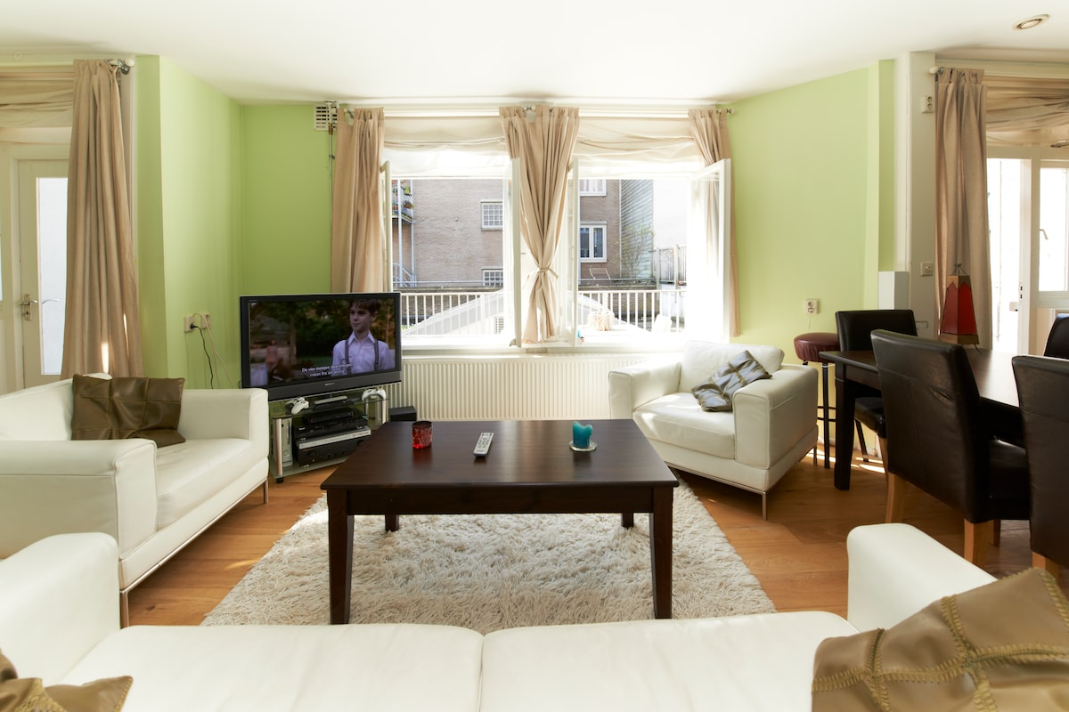 "The living room is equipped with a 40"" flat screen TV, DVD player, speakers, and Xbox 360"