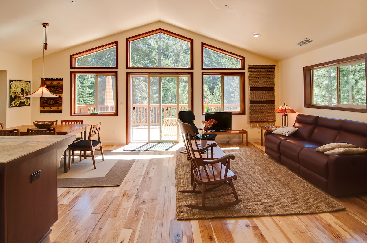 spacious great room on second floor with private deck looking out to the gorgeous fir and pine trees