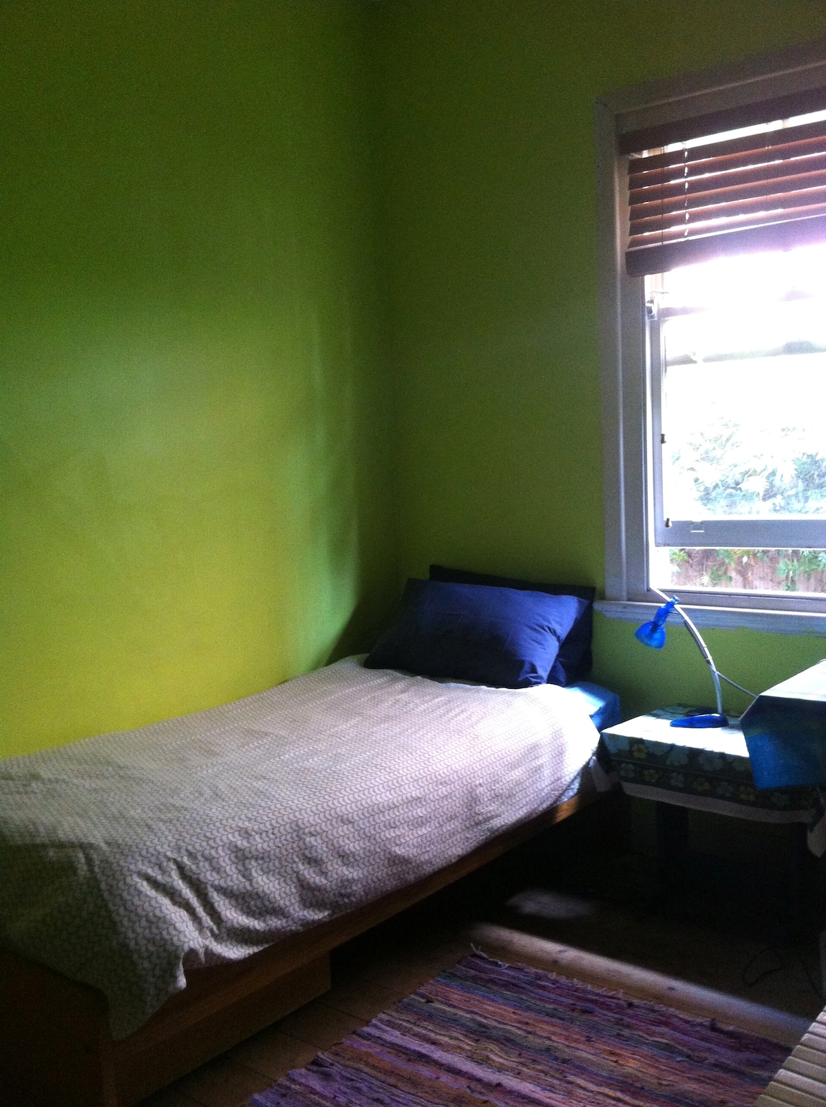 Comfortable single bed in a quiet sunny room.
