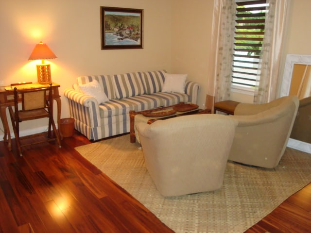 BEAUTIFUL TIGERWOOD HARDWOOD FLOORS GRACE THIS QUAINT LIVING ROOM SPACE