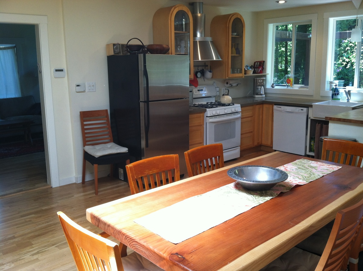 Open space ,kitchen and dining area. Our handmade dining table made by Harvey. Local redwood large and fun to eat around.