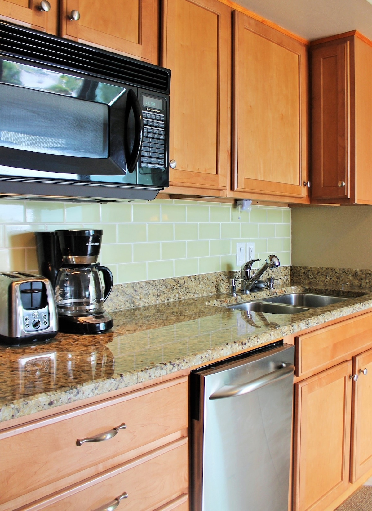 Deep stainless steel sink and stainless steel dishwasher.