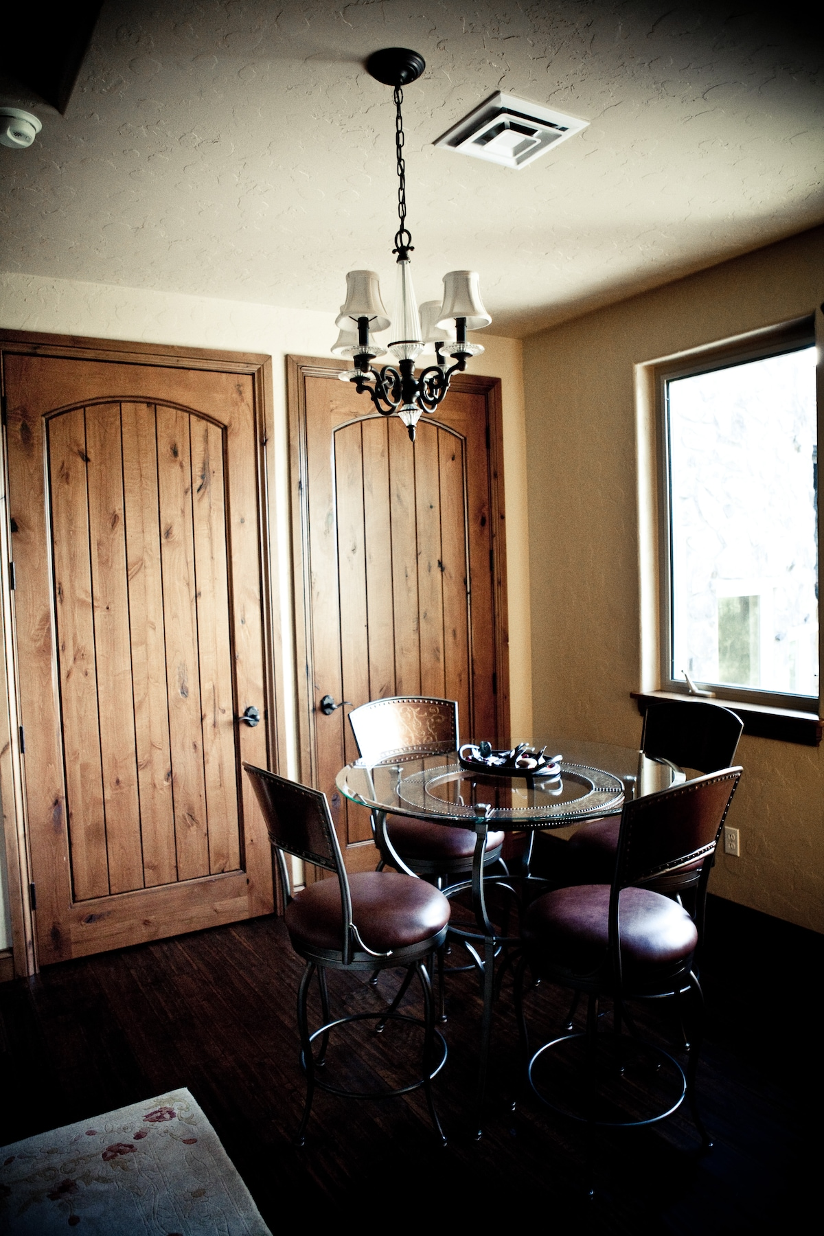 Antechamber with kitchenette in armoire. Enjoy dinner or games around the table- all overlooking Lake Mayfield, the Cowlitz & Tilton Rivers, Koi Pond and watermusic below from the entry fountain! Breakfast is self-catered from a very well-stocked pantry a