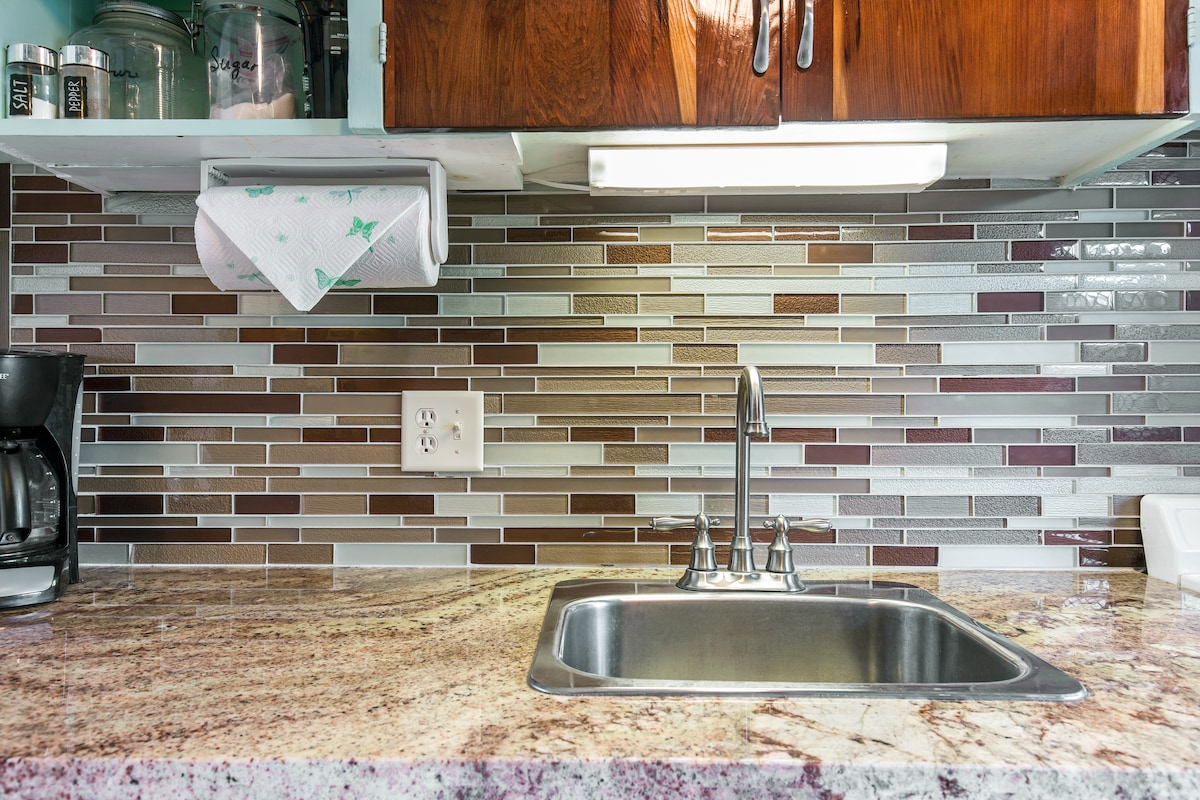 New granite counters and colorful tile back splash.