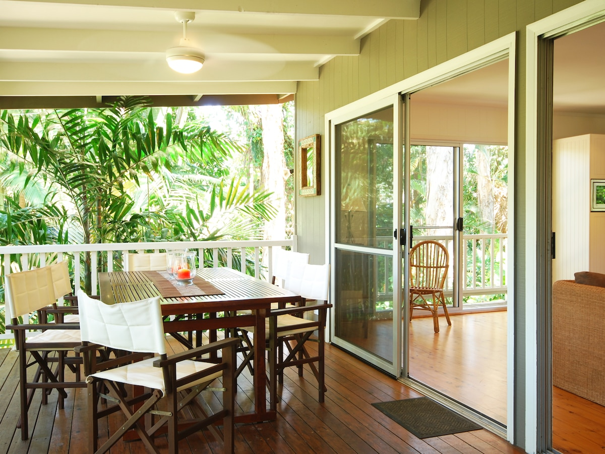 Along the front of the house the spacious verandah catches the sea breeze