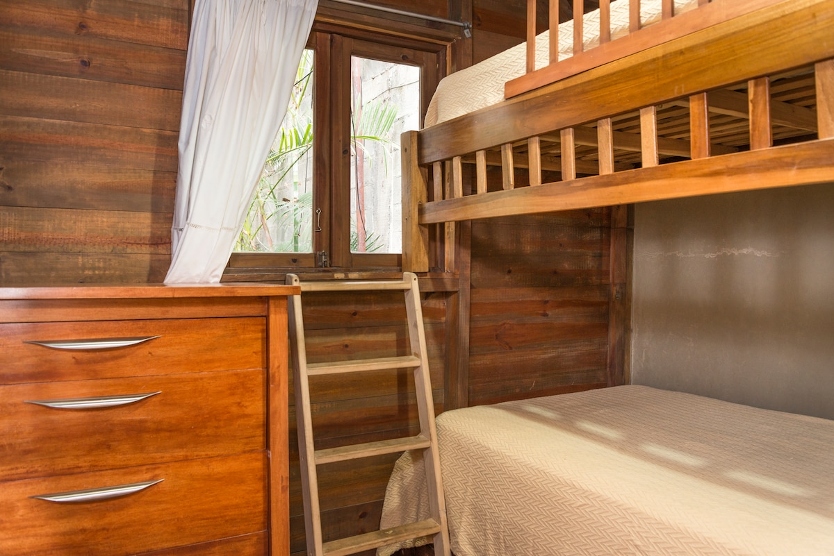 Third bedroom with bunk beds and dresser.