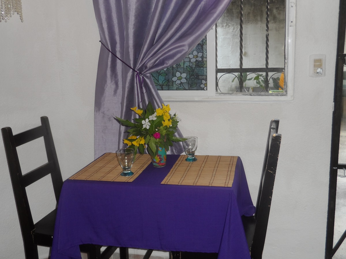 Your dinner place with fresh flowers from the garden.