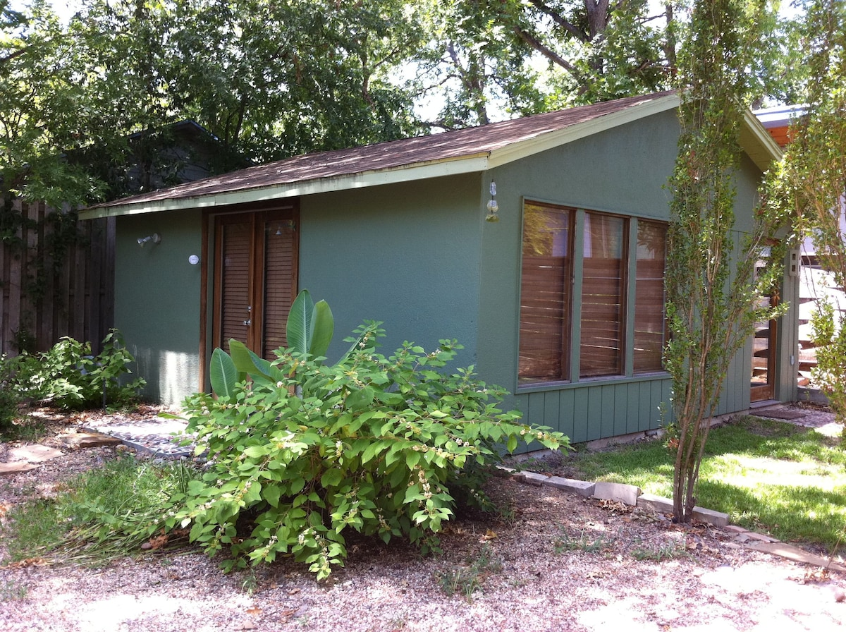 Detached vacation studio in back of our garden.  Entry at french doors (left).