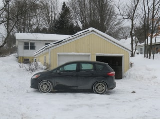 Parking area below the garage is open 365.