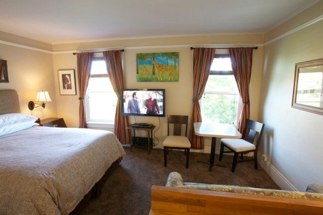 Across from the bed is a little seating area and a comfortble loveseat.  The two windows are bright!