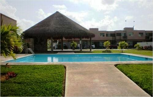 Palapas, Pool and Green Areas of the Housing Development