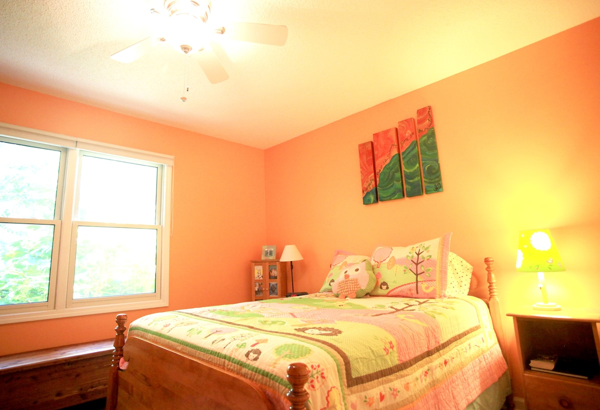 Full-sized bed in the guest room - comfy for two people. Awesome natural light.