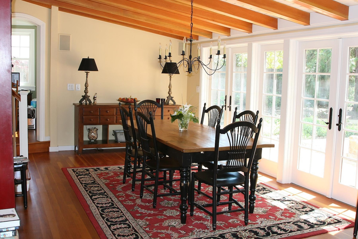 Main house dining room table seats 10